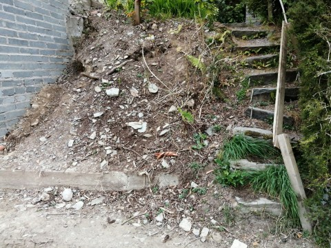 Steep slope next to wall